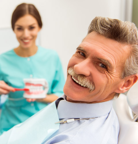 Female dentist with elderly patient